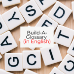 Scrabble tiles in disarray with a card that says Build-A-Glossary